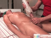 Masseuse uses a fleshlight on his cock