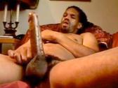 Dredded black guy strokes his long dick