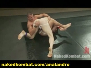 Muscle Healthy Men in Oil Combat Wrestling