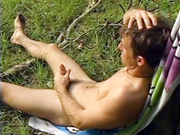 handsome guy masturbates outdoors