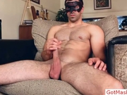 Masked dude stroking and wanking his cock