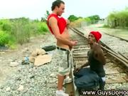 Black gangster dude gives white guy a blowjob