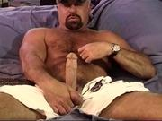 Hunky bear squeezes his own balls