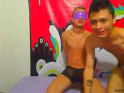 Two cute guys playing bondage games on webcam
