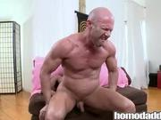 Buff bald daddy rides a big black cock